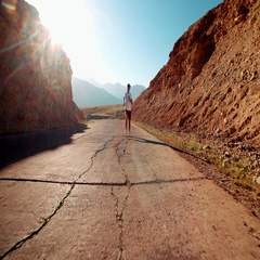 Young Asian man Jogging along the old mountain road, healthy way of life, the Stock Footage