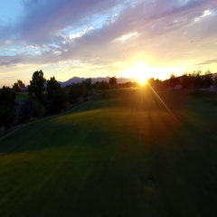 4K Aerial Drone Desert Golf Course Fly Backwards Wide Reveal Pin Flag Sunset Stock Footage