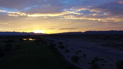 4K Aerial Drone Desert Golf Course Fly Sideways Sunset Water Reflection Stock Footage