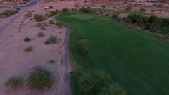 4K Aerial Drone Desert Golf Course Fly Forward Reveal Purple Clouds Stock Footage