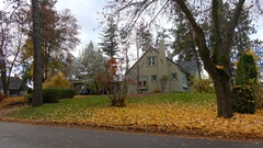 Architecture, 1930s one and half story home on quiet street, autumn Stock Footage