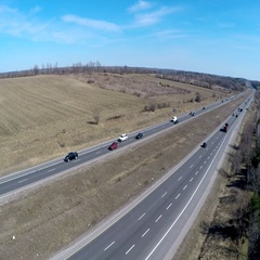 Drone shot of a 4 lane divided highway Stock Footage