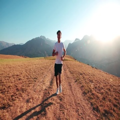 Mountain landscape Asian running man Jogging in the morning slow motion Stock Footage