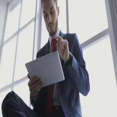 Young coworker businessman in office using digital tablet Stock Footage