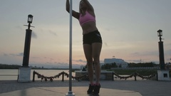 Street Pole dance on sunset stock footage video Stock Footage