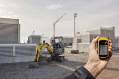 Finding the right position inside a construction site via gps ( blurred backgrou Kuvituskuvat
