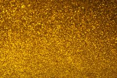 Abstract glitter golden glowing background Stock Photos