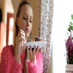 Calm, thoughful girl sitting in the cafe and eating delicious cake Stock Footage