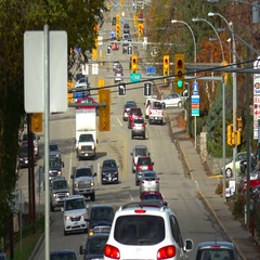 Traffic on hilly road with traffic lights, autumn Stock Footage
