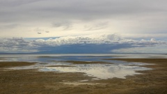 Movement of the clouds over the salted lake Durgun Nuur, Mongolia. Full HD. Stock Footage