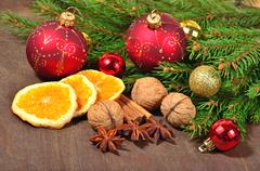 Different kinds of spices, nuts and dried oranges, Christmas decoratio Stock Photos
