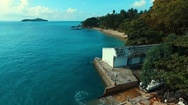 Aerial: Flying to wild beach. Stock Footage