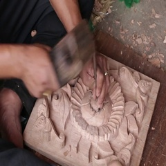 Nepali man are making wooden souvenirs for tourists in Kathmandu, Nepal Stock Footage