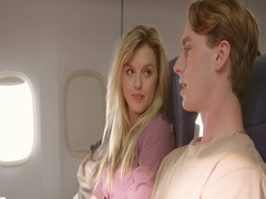 Loving young couple traveling in main cabin of commercial airliner 4K Stock Footage