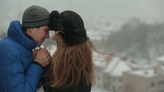 Сouple in the winter park. Man and woman hugging in the park in winter Stock Footage
