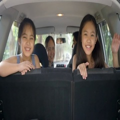 Slow motion of Happy Asian family on mini van preparing for travel on vacation Stock Footage
