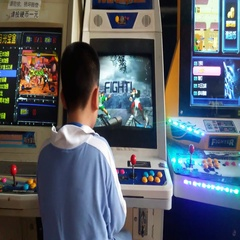 Chinese pupils playing video games in the net bar after school Stock Footage