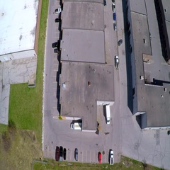 Large industrail warehouse, fly over an Industrial Park Stock Footage