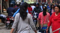 People make their way through a busy shopping street in Kathmandu, Nepal Stock Footage