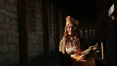Beautiful blonde bride in ethnic dress at the medieval castle Stock Footage