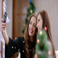 Women taking selfie at christmas party Stock Footage