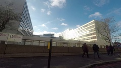 Left Side View Of A Driving Plate Car Travels By St Thomas Hospital London Stock Footage