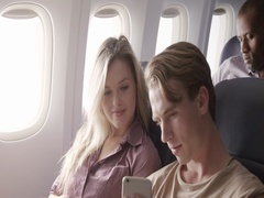 Young couple watch content on smart phone while flying on airliner MCU 4K Stock Footage