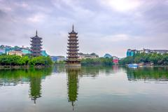 Two towers, pagodas of Sun and Moon by the lake. Top tourist attraction in Guili Stock Photos