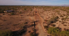 High Angle Aerial View of Pickup Truck on a Typical Arizona Desert Road  	 Stock Footage