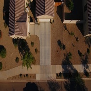 Aerial View of Truck Pulling Into Residential Driveway   Stock Footage