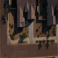 Aerial View of Truck Pulling Out of Residential Garage and Driveway  	 Stock Footage