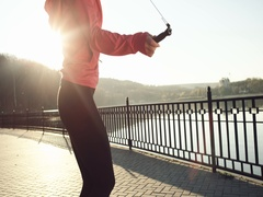 Amazing detail of hands an jumping women on the jump rope. Outdoor sports Stock Footage
