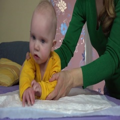 Mother preparing to massage little baby daughter . 4K Stock Footage