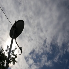 Satellite Antenna. The Wind. Sunny Day. Clouds. Timelapse Stock Footage
