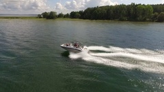 Amazing footage of a boat racing through the river in daylight Stock Footage