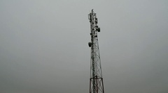 Flying near the cell tower mobile operator and the other transmitting signals Stock Footage