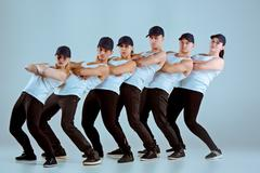 Group of men and women dancing hip hop choreography Kuvituskuvat