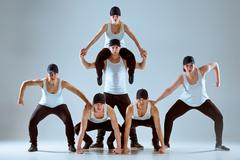 Group of men and women dancing hip hop choreography Kuvituskuvat
