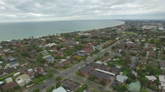 Slow descend above Frankston suburb also showing Mornington Peninsula waters Stock Footage