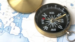 Compass left panning on the world map searching the north Stock Footage