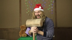Evil dwarf or bad santa gifts guards with a wooden mallet Stock Footage