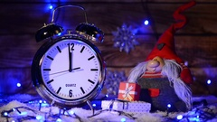 Xmas set with big alarm clock counting to twelve o'clock Stock Footage