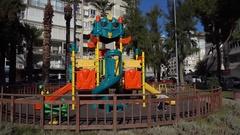Child alone near big construction of playground Stock Footage