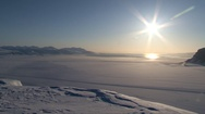Landscape of Tempelfjorden with frozen inlet, Sun standing low on the Stock Footage