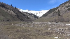 Rocky River Gorge snow-capped peaks Stock Footage