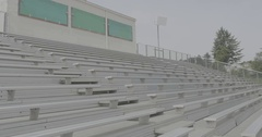Row of white bleachers in the stadium Stock Footage