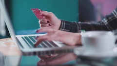 Online shopping in the cafe with the credit cards. Online shopping Stock Footage