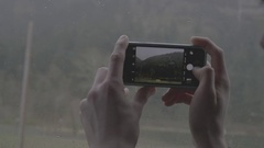 Person photographing Columbia river and Canadian Rockies with his mobile phone Stock Footage
