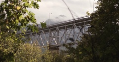 Vehicles passing on the iron bridge in Canadian Rockies Stock Footage