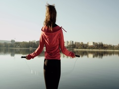 Close-up of back an jumping women on the jump rope. Outdoor sports. Stock Footage